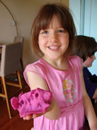 girl holding clay project in hand